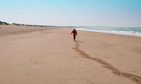 man-deserted-beach-25738300