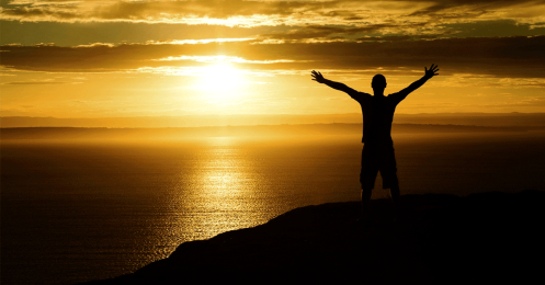 14462-sunset-mountain-silhouette-person-arms-raised-social.1200w.tn_